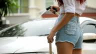 Woman washing a car video