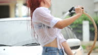 Woman washing a car video