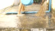 Woman washing cement floor video
