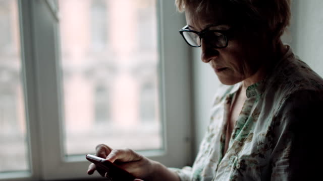 Woman watching something on the smartphone screen video