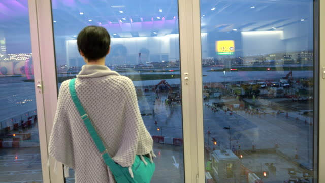 Woman watching the airplanes taking off video