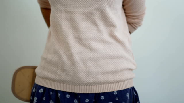 woman wearing back support belt video
