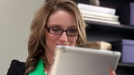 Woman wearing glasses with tablet video