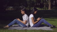 Woman wearing in casual top and jeans use application on cell video