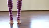 Woman wearing leg warmers video