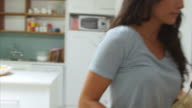 Woman Wearing Pajamas Getting Orange Juice From Refrigerator video