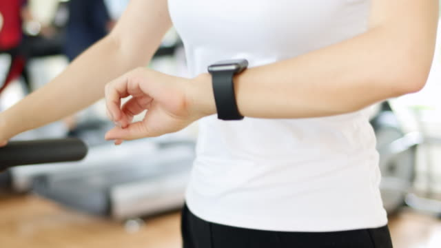 Woman wearing smart watch exercise video