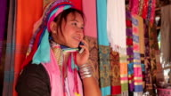 woman wearing the traditional with mobile phone at a weaving in village video
