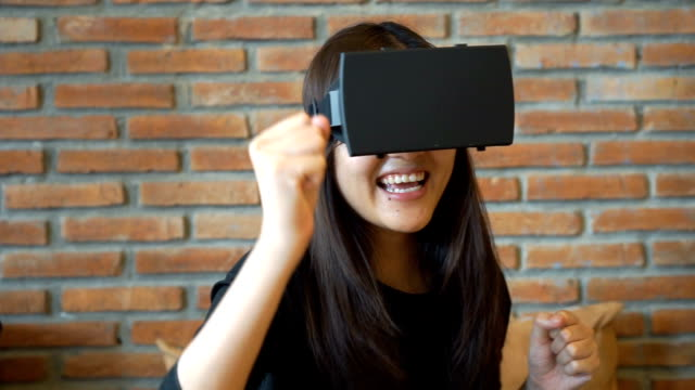 Woman wearing Virtual Reality Headset at Home video