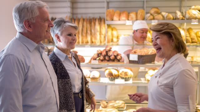 Woman welcoming customers to the bakery video