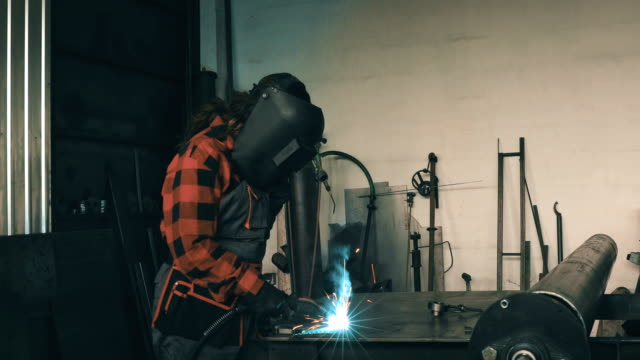 Woman welder in workshop 4K video