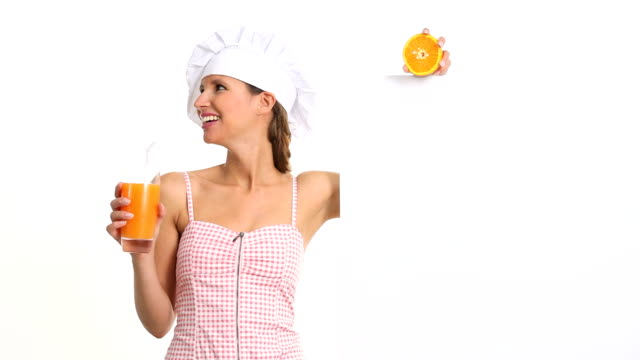 woman who explains the diet and wellness drinking orange juice video