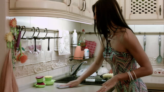 Woman wipes kitchen table video