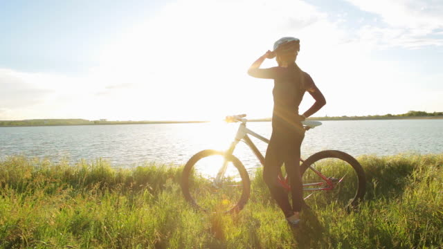 Woman with a bicycle enjoying the view. video