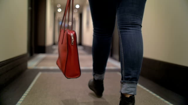 Woman with bag walking in hotel hall video