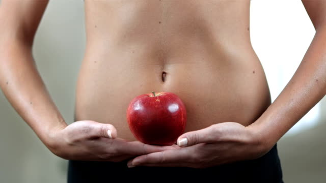 HD DOLLY: Woman With Beautiful Body Holding An Apple video