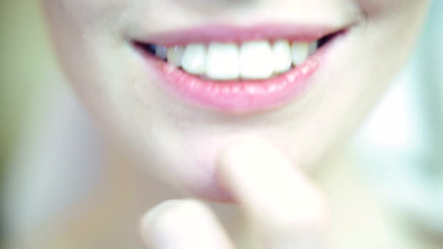 Woman with beautiful smile biting finger video