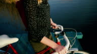 Woman with bicycle near the lake video