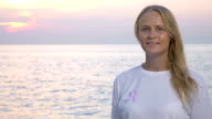 Woman with breast cancer awareness ribbon video