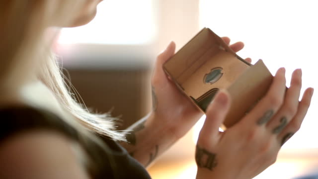 Woman with Cardboard VR - Handheld video