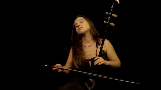 Woman with chinese violin erhu video