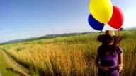woman with colorful ballons video