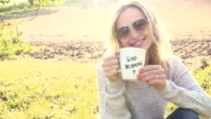 Woman with cup of coffee video