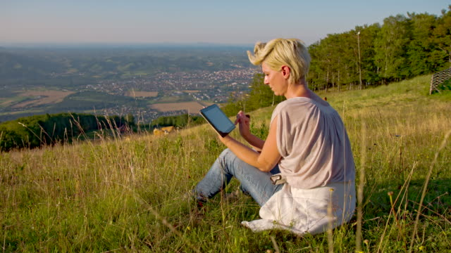 WS DS Woman With Digital Tablet Sitting On Hill video