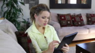 Woman with digital tablet video