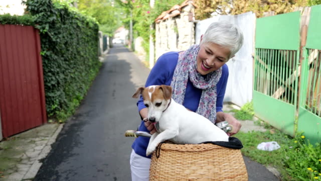Woman with dog on bicycle video