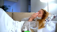 A Woman With Fever Uses Nasal Spray And Sneezes video