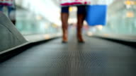 Woman with fridge bag on Moving walkway video