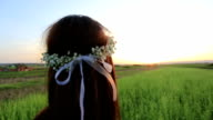 Woman with hair flower wreath video