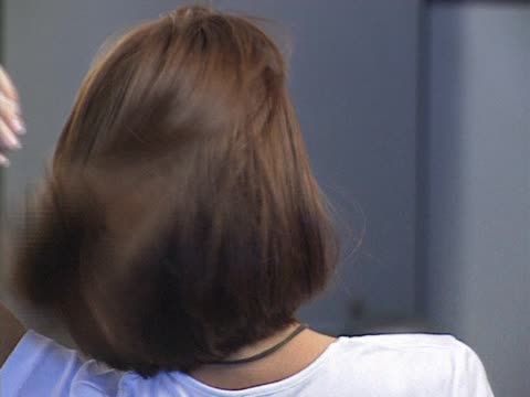 Woman with hands in hair video