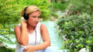 Woman with headphone listen to music outdoor video