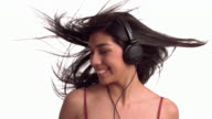 Woman with headphones dancing video
