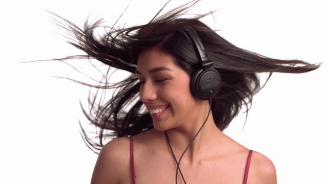 Woman with headphones dancing video