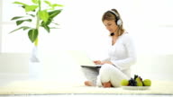 Woman with headset and laptop. video