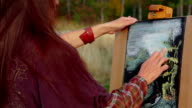 Woman With Long Brown Hair Drawing A Picture At Plein Air video