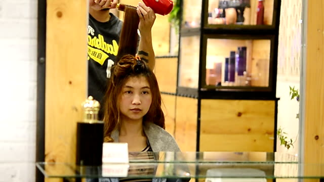 Woman with long hair at the beauty salon getting a blower video