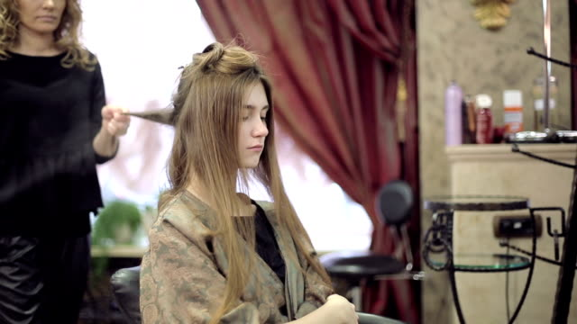 Woman with long hair at the beauty salon video