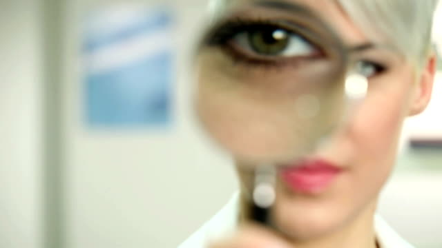 Woman with magnifying glass video