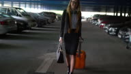 Woman with orange suitcase video