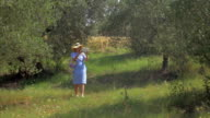Woman with pad taking nature pictures video