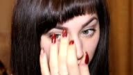Woman with red lips preening video