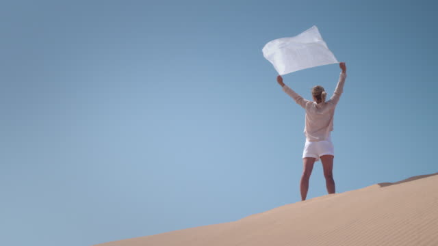Woman with scarf in desert video