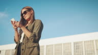 Woman with smartphone on rooftop video