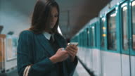 Woman With Smartphone Travelling By Subway video
