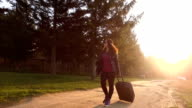Woman with suitcase. Slow motion video