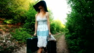 Woman with suitcases video